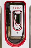 Tesla Superchargers in a line. SARN, UNITED KINGDOM - AUGUST 2, 2018 : A row of Tesla Superchargers at the Sarn Park motorway services off the M4 near Bridgend stock photos