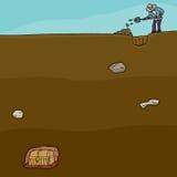 Tesoro Hunter Digging Foto de archivo libre de regalías