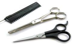 Tesouras do pente do barbeiro Imagem de Stock