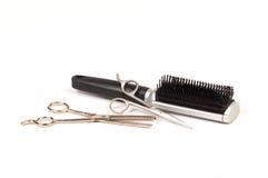 Tesouras e escova do cabelo Fotografia de Stock
