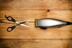 Tesouras e lâmina elétrica Fotos de Stock