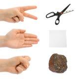 Tesouras, papel, pedra - mãos Fotos de Stock