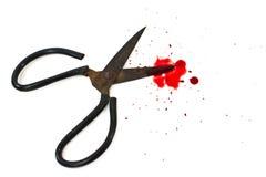 Tesouras velhas e uma gota de sangue. Fotos de Stock