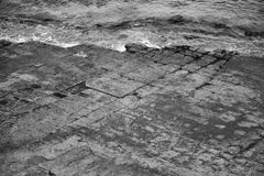 Tessellated Pavement in Pirates Bay. Black and White. Stock Images