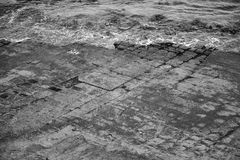Tessellated Pavement in Pirates Bay. Black and White. View of Tessellated Pavement in Pirates Bay, Tasmania. Black and White Royalty Free Stock Photos