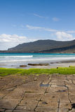 Tessellated pavement in Tasmania. Natural formations in the rock by the sea, known as the Tessellated Pavement, Eaglehawk Neck in Tasmania stock photo