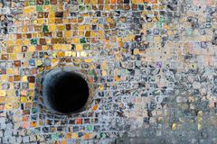 Tessellated surface with a hole. Tessellated colorful old surface with a black hole Royalty Free Stock Photos