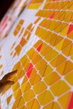 Tessellation of a plane with yellow, orange and red colored triangles on a white background. mathematical and artistic game to co. Ver a surface with geometric royalty free stock photo