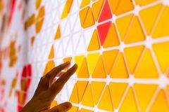 Tessellation of a plane with yellow, orange and red colored triangles on a white background. mathematical and artistic game to co. Ver a surface with geometric royalty free stock photos