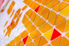 Tessellation of a plane with yellow, orange and red colored tria. Ngles stock images