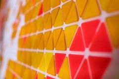 Tessellation of a plane with yellow, orange and red colored tria. Ngles Stock Photo