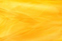 Tessuti gialli del fondo Immagine Stock