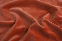 Tessuto arancione del velluto fotografia stock