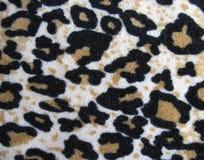 Tessuto bianco e marrone Fleecy della pelle del leopardo immagini stock