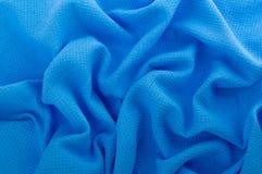Tessuto blu come fondo. Immagine Stock Libera da Diritti