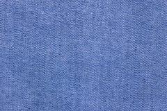 Tessuto blu del denim, struttura dei jeans del cotone Fotografie Stock Libere da Diritti