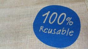 Tessuto del tessuto della iuta e logo stampato a mano Immagine Stock Libera da Diritti