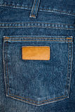 Tessuto delle blue jeans con la casella ed il contrassegno Fotografia Stock Libera da Diritti