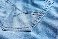 Tessuto delle blue jeans con la casella posteriore Immagini Stock