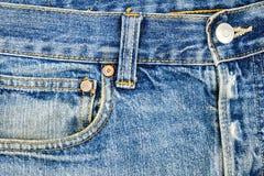 Tessuto delle blue jeans con la tasca Immagine Stock