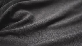 Tessuto di cotone grigio Uso come fondo stock footage