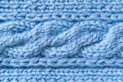 Tessuto di lana blu con un modello della treccia fotografia stock libera da diritti