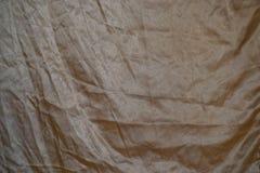 Tessuto di seta dorato Fotografie Stock Libere da Diritti