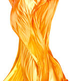 Tessuto di seta dorato del fuoco isolato su bianco Immagine Stock