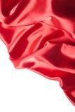 Tessuto di seta rosso sopra priorità bassa bianca Fotografia Stock Libera da Diritti