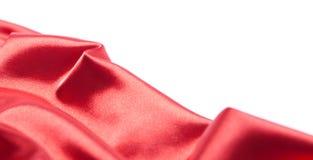 Tessuto di seta rosso sopra priorità bassa bianca Fotografie Stock Libere da Diritti
