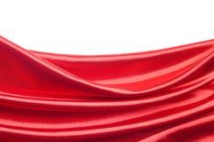 Tessuto di seta rosso sopra priorità bassa bianca Immagine Stock