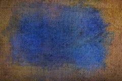Tessuto di trama con macchia blu, fondo strutturato fotografie stock