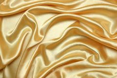 Tessuto dorato Fotografia Stock