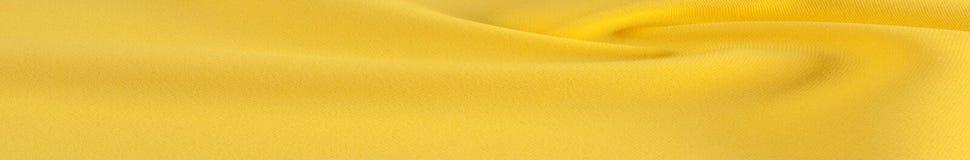 tessuto giallo di seta pesante il tessuto di seta di 100% è spesso, ma elastico Immagini Stock