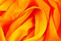 Tessuto giallo ed arancio sgualcito Fotografia Stock Libera da Diritti
