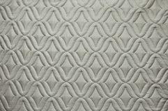 Tessuto grigio con il modello astratto per l'immagine di sfondo fotografie stock