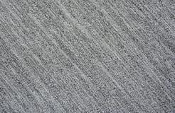 Tessuto grigio con la struttura diagonale di un filetto fotografia stock