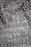 Tessuto grigio dei jeans con la tasca Fotografia Stock