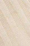 Tessuto lavorato a maglia beige. fotografia stock libera da diritti