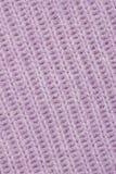 Tessuto lavorato a maglia lillà. fotografia stock
