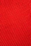 Tessuto lavorato a maglia rosso. fotografia stock