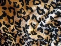 Tessuto marrone Fleecy della pelle del leopardo (velor)) Immagini Stock