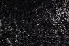 Tessuto nero brillante rettangolare con gli zecchini Fotografia Stock