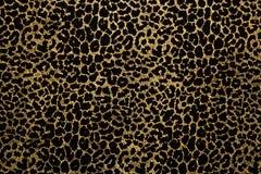 Tessuto nero con la stampa dorata della pelliccia del leopardo fotografia stock