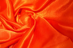 Tessuto rosso-arancione del raso Fotografia Stock Libera da Diritti