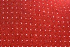 Tessuto rosso dell'annata con i puntini bianchi Fotografia Stock