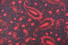 Tessuto rosso e nero con il modello di Paisley Fotografia Stock