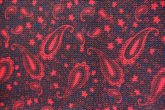 Tessuto rosso e nero con il modello di Paisley Immagine Stock