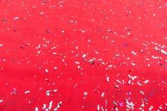 Tessuto rosso pepato con i coriandoli Immagini Stock Libere da Diritti