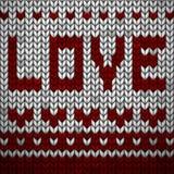 Tessuto tricottato bianco con un AMORE rosso dell'iscrizione e dell'ornamento illustrazione di stock